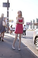 Red Dress Explorer Girl Goes Through The Beach And City - Picture 1