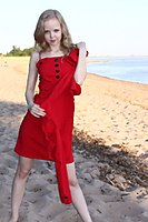 Red Dress Explorer Girl Goes Through The Beach And City - Picture 10