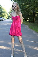 Red Dress Explorer Girl Goes Through The Beach And City - Picture 2