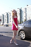 Red Dress Explorer Girl Goes Through The Beach And City - Picture 5
