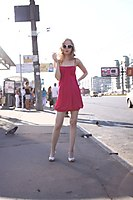 Red Dress Explorer Girl Goes Through The Beach And City - Picture 6