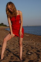 Red Dress Explorer Girl Goes Through The Beach And City - Picture 7